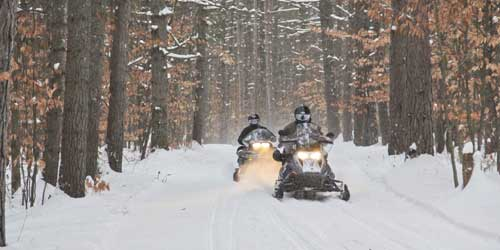 Snowmobiling at _White-Lake-credit-NH Division of Travel and Tourism Development